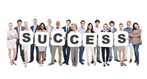 Group of People Holding The Word Success Stock Images