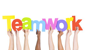 Group Of People Holding The Word Teamwork Royalty Free Stock Photos