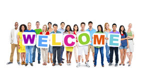 Group of People Holding Word Welcome Royalty Free Stock Photos