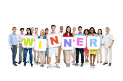Group of People Holding Word Winner Stock Photography