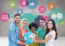 Group of people holding world globe in front of app graphics Stock Photo