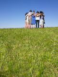 Group of People in Huddle in Field Royalty Free Stock Photo