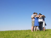 Group of People in Huddle in Field Royalty Free Stock Image