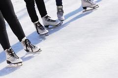 Girls on skating rink. Group of people on the ice rink stock image