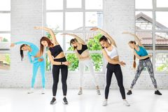 A group of people involved in sports in the dance class. The concept of sports, a healthy lifestyle, fitness, stretching and. Dancing stock photos