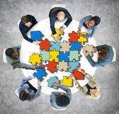 Group of People with Jigsaw Puzzle in Photo and Illustration stock illustration