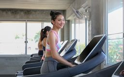 Group people are jogging on a fitness treadmill. Young people ru royalty free stock image