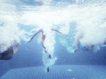 Group of people jumped down to the swimming pool underwater shot Stock Images
