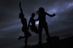 Group of people jumping in air. In night Royalty Free Stock Photos