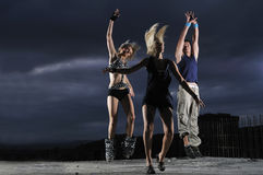 Group of people jumping in air. In night Stock Photo