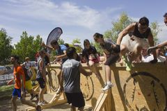 Group of people jumping over an obstacle Stock Photos