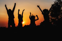 Group people jumping silhouette. With sunset Royalty Free Stock Photos