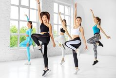 A group of people jumping to dance in a dance class. The concept of sports, a healthy lifestyle, fitness, stretching and dancing.  royalty free stock photo