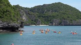 Group of People Kayaking in Tropical Sea. Shot with a Sony RX10 IV fps 59,94 FHD stock footage