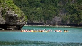 Group of People Kayaking in Tropical Sea. Shot with a Sony RX10 IV fps 59,94 FHD stock video