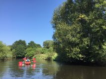 People kayaking on Wieprza river Poland Stock Photos
