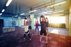 Group of people with kettlebells exercising in gym Stock Photography