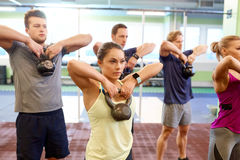 Group of people with kettlebells exercising in gym Royalty Free Stock Image