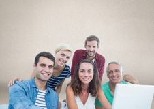Group of people on laptop in front of brown background. Digital composite of Group of people on laptop in front of brown background Stock Photo