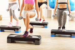 Group of people lifting barbells. Group of happy women doing aerobics Stock Photo