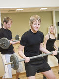 Group of people lifting weights Stock Photography