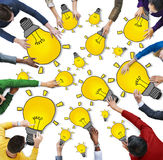 Group of People with Light Bulb Symbol Royalty Free Stock Photos