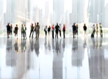Group of people in the lobby business center. Abstakt image of people in the lobby of a modern business center with a blurred background Stock Photos