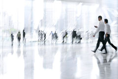 Group of people in the lobby business center. Abstakt image of people in the lobby of a modern business center with a blurred background Royalty Free Stock Photography