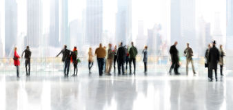 Group of people in the lobby business center. Abstrakt image of people in the lobby of a modern business center with a blurred background Royalty Free Stock Photography