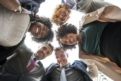 Group of People Looking Downwards to the Camera Stock Photography
