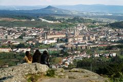 Group of people looking at Santiago de Compostela view stock photo