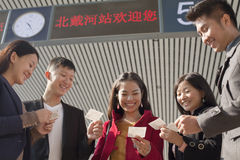 Group of people looking at tickets at the railway station Stock Photo