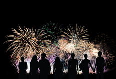 Group of people looks beautiful colorful holiday fireworks Royalty Free Stock Images