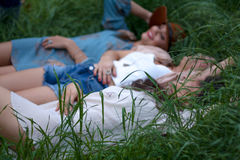Group of People Lying on Green Grass Stock Image