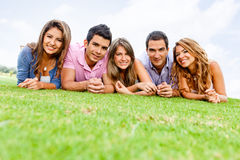 Group of people lying outdoors Royalty Free Stock Photography