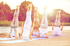 Group of people making yoga exercises outdoors Royalty Free Stock Photo