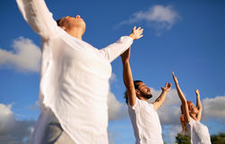 Group of people making yoga or meditating outdoors Royalty Free Stock Image