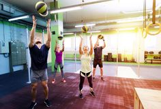 Group of people with medicine ball training in gym Royalty Free Stock Image