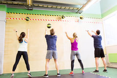 Group of people with medicine ball training in gym Stock Photos