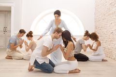 Group of people meditating indoors. Young family therapy royalty free stock photos
