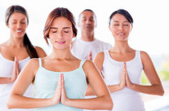 Group of people meditating Stock Photos