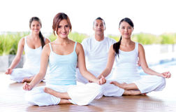 Group of people meditating Stock Photo