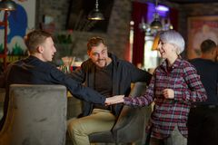 A group of people, meet at a bar. Indoors. stock photography