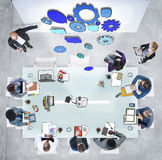 Group of People in a Meeting and Gear Symbol Royalty Free Stock Images
