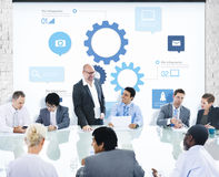 Group of People Meeting with Gear Symbols. Multiethnic Group of People Meeting with Gear Symbols Royalty Free Stock Images