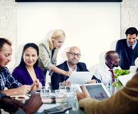 Group of People Meeting with Projection Screen.  Stock Photography