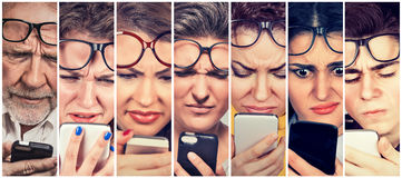 Group of people men and women with glasses having trouble seeing cell phone. Vision problems. Bad text message royalty free stock photos