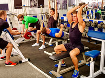 Group of people  men working with dumbbells  at Stock Photo