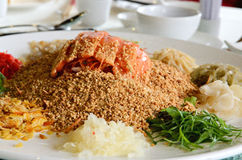 A group of people mixing and tossing Yee Sang dish with chop sticks. Royalty Free Stock Photography
