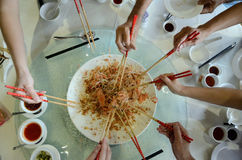 A special dish during Chinese New Year called Yusheng or Yee Sang Stock Images